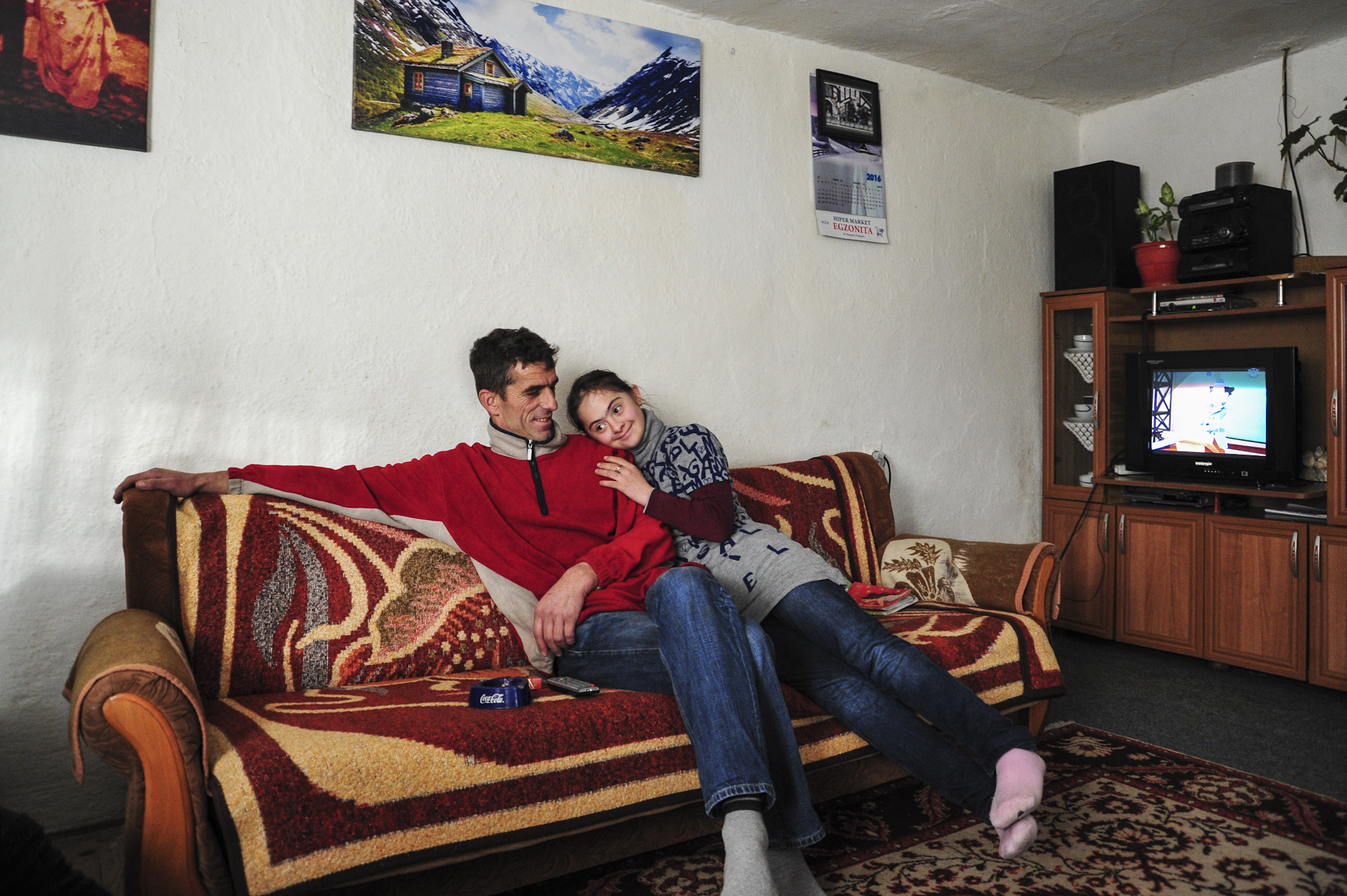 Shemsi and his daughter Fjolla at their house. Photo: Atdhe Mulla.