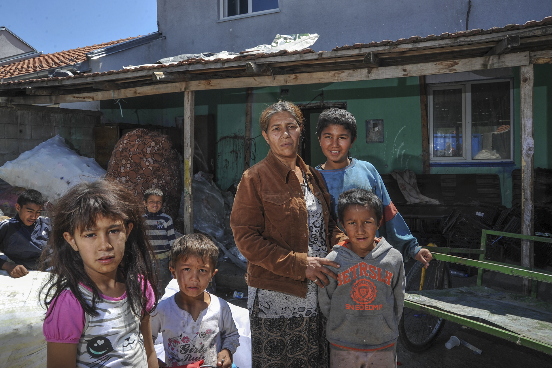Fetije Sevdiu stands in front of her house in the Roma mahalla in Mitrovica. Photo: Atdhe Mulla.