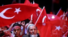 People wave Turkish flags as they take part in an anti coup rally at Taksim square in Istanbul, Tuesday, July 26, 2016. Turkey's polarized factions should learn from their mistakes and overcome their antagonism, the main opposition leader Kemal Kilicdaroglu said during an interview with The Associated Press.   (AP/Beta).