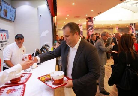 Prishtina's mayor, Shpend Ahmeti, getting his bucket. Photo courtesy of the US Embassy in Kosovo.