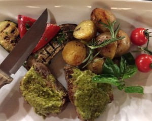 The steak with pesto sauce was the best dish on the table.