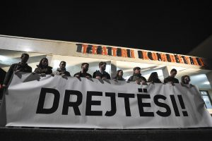 Mourners held a banner demanding justice. | Photo: Atdhe Mulla