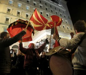 Supporters of the ruling conservative VMRO-DPMNE party celebrate the victory in general elections, in front of the party headquarters in Skopje, Macedonia, early Tuesday, Dec. 13, 2016. Macedonia's dominant conservative coalition has won a narrow victory over the main opposition Social Democrats in early national elections, although without enough seats in parliament to govern alone, final results showed late Monday. | Photo: Beta / AP Photo, Boris Grdanoski