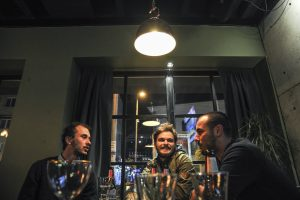 Genc Buca, Tanju Serif, and Genc Mehmeti share drinks at Soho Cafe in Gjilan. | Photo: Atdhe Mulla