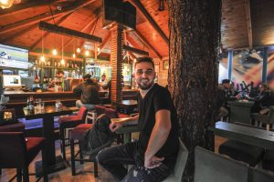 Sami Bunjaku, 32, in his Kamenica Bar The Sun. | Photo: Atdhe Mulla