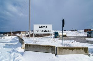 January 6, 2015 – Camp Bondsteel, Kosovo – Entrance to Camp Bondsteel near Ferizaj. Many Kosovars worked here before traveling to Afghanistan, Iraq, and now various countries throughout Africa to work with U.S. government contractors. | Photo: Valerie Plesch