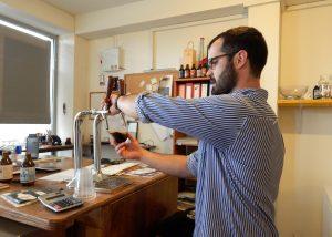 Alex Butler pours a smoked porter at Sabaja brewery.   Photo: Faith Bailey