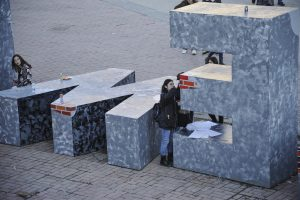 Youth painting the Newborn monument in central Prishtina, in preparation of the ninth anniversary of Kosovo's indepenence.